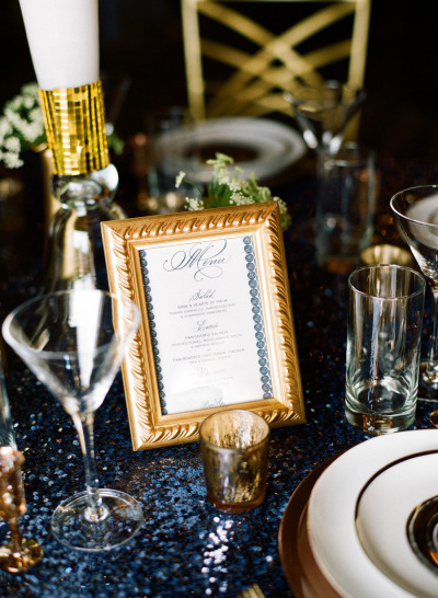Hand Calligraphy menu card in navy blue framed in gold