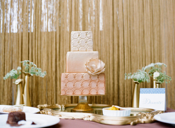 Elegant ombre cake with tented hand calligraphy dessert sign