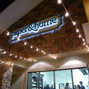 Paper and Home Storefront Sign with Bistro Lighting