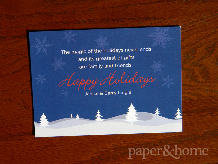 Snowflakes, snowy trees and hills holiday card