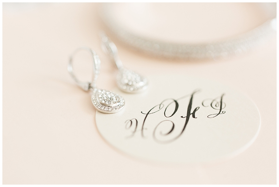 Classic wedding monogram invitation seal with bride's jewelry