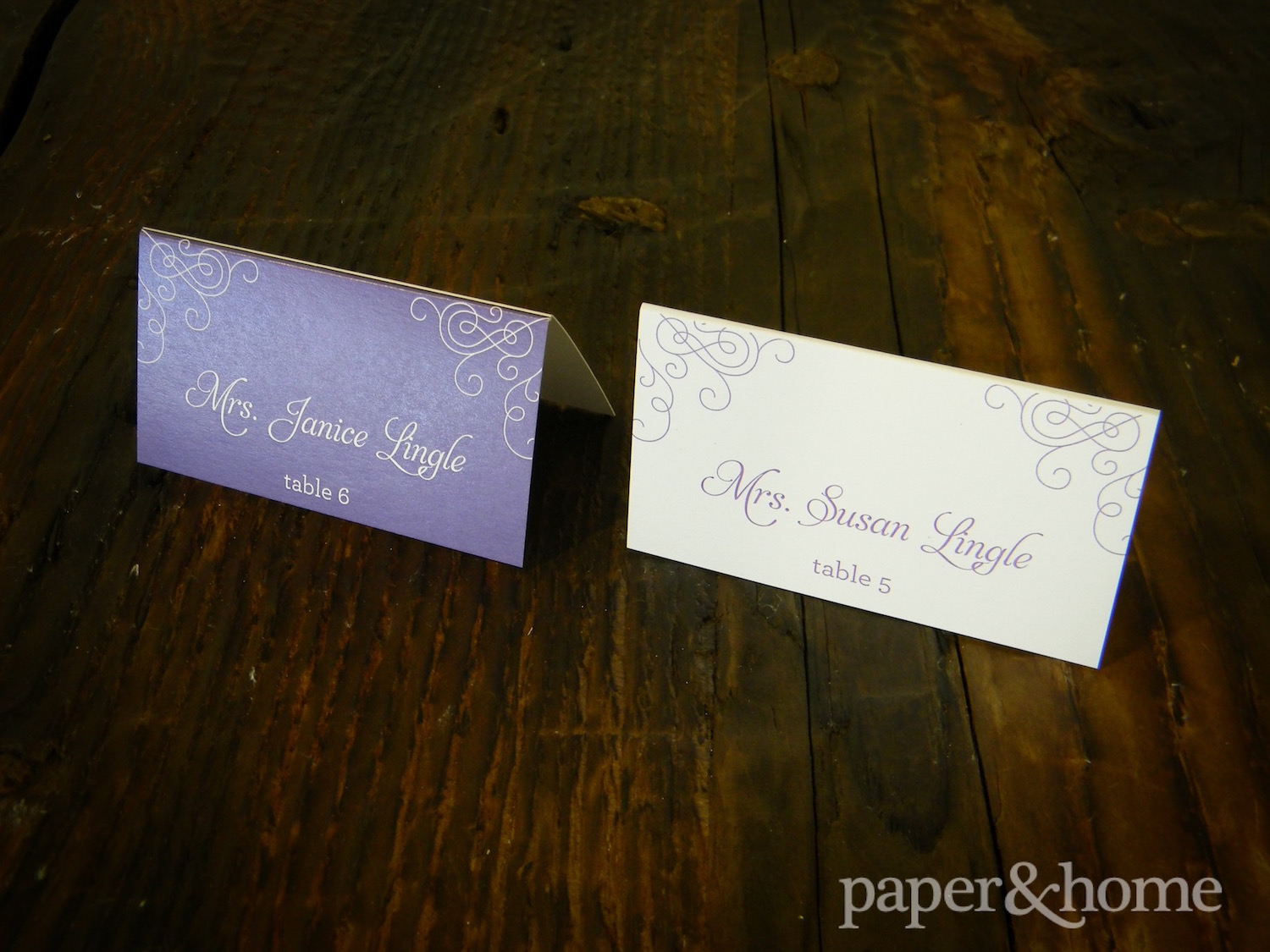 purple and white escort cards